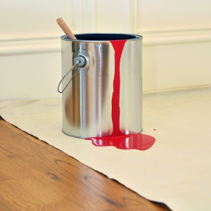 red paint can on eliminator drop cloth