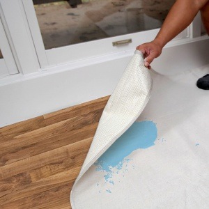 lifting edge of stay put canvas to show leak resistance