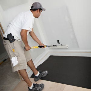 man painting on supertuff surface protector