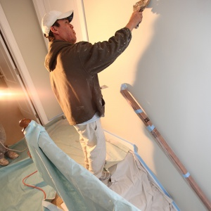 one tuff floor protector and man painting