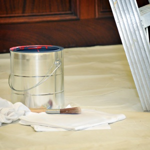 paint can on rubber-duckie drop cloth