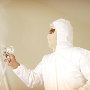 painting with spray sock and painter's hood