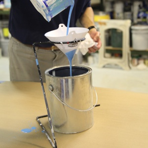 pouring paint in cone strainer